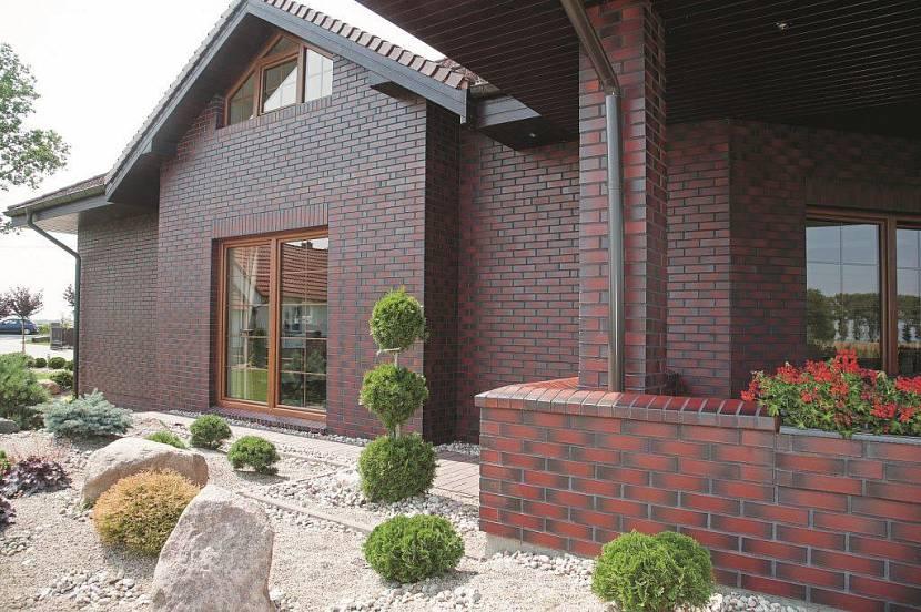 отделка фасада частного дома кирпичом цена