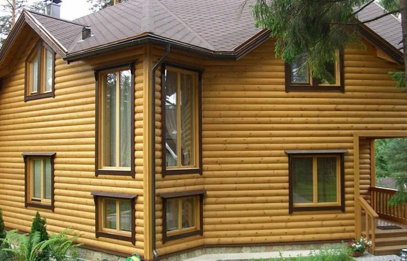 Деревянный сайдинг в облицовке дома