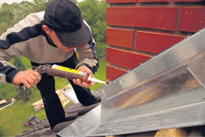Герметизация стыка покрытия с дымовой трубой